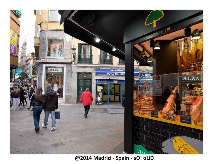 Glimpse of the street.  Serrano Ham Shop.